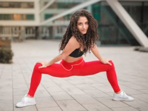 selective-focus-photo-of-smiling-woman-in-red-yoga-pants-and-3764394